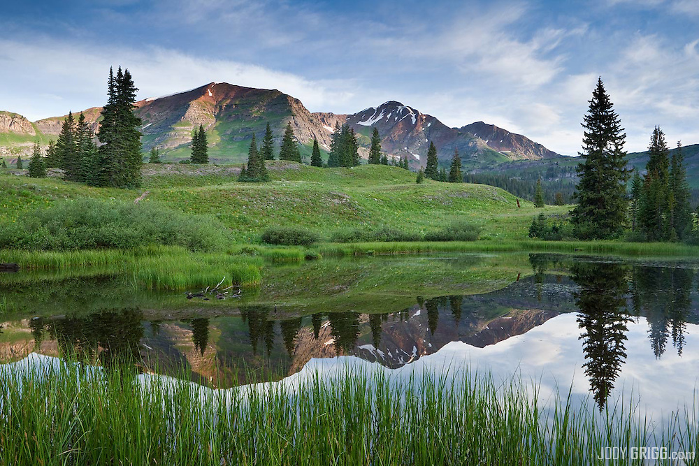 Ruby Peak and Mount Owen reflect in a small unamed pond near Lake Irwin just outside of Crested Butte.