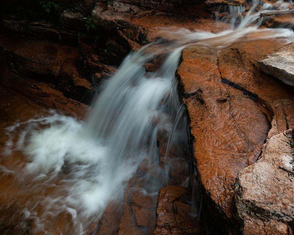 Mountain water sliding through the weathered terrain at Bemis Brook Falls.