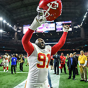 Kansas City Chiefs outside linebacker Tamba Hali (91) celebrated with the team's fans following the 30-0 win over the Houston Texans during Saturday's AFC Wild Card football game on January 9, 2016 at NRG Stadium in Houston, Texas.