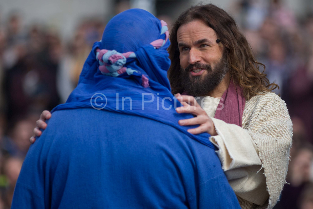 London, 25th March 2016: The Passion of Jesus is performed in Londons Trafalgar Square by members of Wintershall Trust. Played annually on Good Friday it celebrates the cruxifixion and resurrection of Jesus Christ. The cast re-enacts the Christian Biblical story to an audience of thousands and the main character is played by professional actor James Burke-Dunsmore.