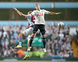 Tottenham Hotspur's Kyle Walker and Aston Villa's Jordan Bowery go for the ball   - Photo mandatory by-line: Nigel Pitts-Drake/JMP - Tel: Mobile: 07966 386802 24/09/2013 - SPORT - FOOTBALL -  Villa Park - Birmingham - Aston Villa v Tottenham Hotspur - Round 3 - Capital One Cup