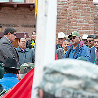 Navajo Nation Council speaker LoRenzo C. Bates, left, listens to Vern Lee, 65, as he addresses the statements made by the speaker, at the steps of the Navajo Nation Council Chambers, in Window Rock on Wednesday.