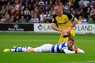Queens Park Rangers striker Jamie Mackie (12) reacts to a missed opportunity shooting at goal as Burton Albion defender Jake Buxton (23) looks on during the EFL Sky Bet Championship match between Queens Park Rangers and Burton Albion at the Loftus Road Stadium, London, England on 23 September 2017. Photo by Richard Holmes.