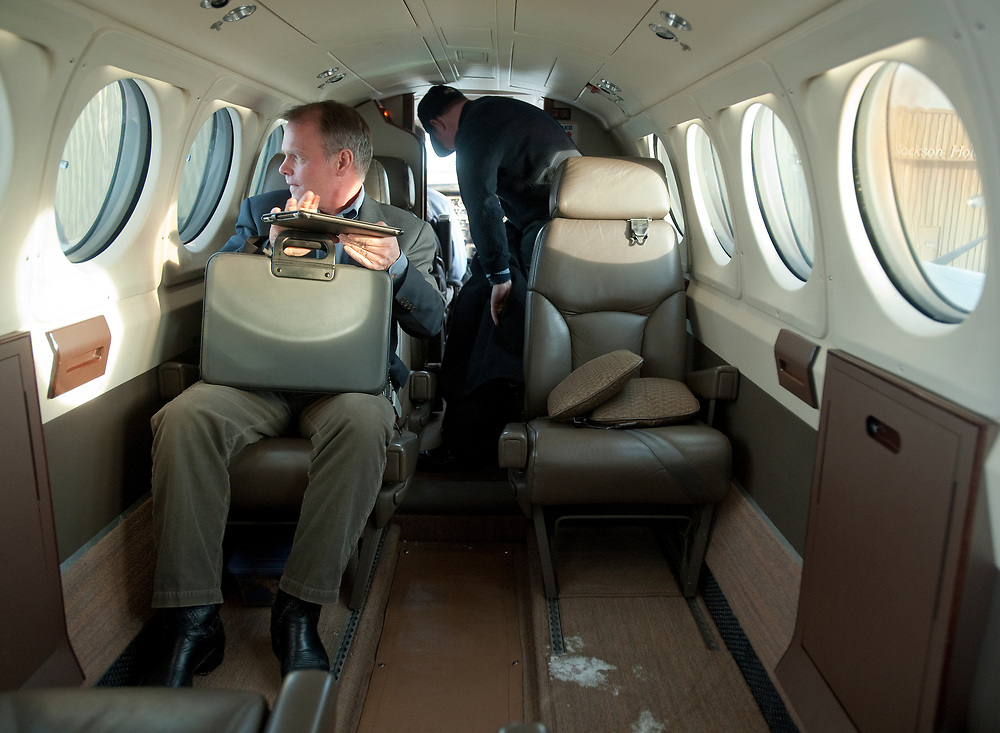 PRICE CHAMBERS / NEWS&GUIDE<br /> University of Wyoming trustee Brad Mead settles into the school's private plane, sent to collect him in Jackson on Jan. 15, 2013.