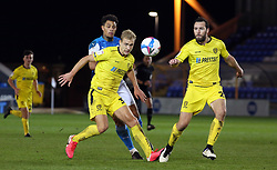 Jonson Clarke-Harris of Peterborough United in action with Sam Hughes and John-Joe O'Toole of Burton Albion - Mandatory by-line: Joe Dent/JMP - 27/10/2020 - FOOTBALL - Weston Homes Stadium - Peterborough, England - Peterborough United v Burton Albion - Sky Bet League One