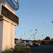 Hot air balloons pass a fast food outlet welcoming the balloonists as they take to the skies around rural Michigan near Battle Creek during the World Hot Air Ballooning Championships. Battle Creek, Michigan, USA. 20th August 2012. Photo Tim Clayton