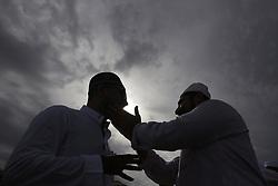 June 16, 2018 - Colombo, Sri Lanka - Sri Lankan Muslims greet and embrace each other after attending Eid al Fitr prayers at Galle Face, Colombo, Sri Lanka on Saturday, 16, June 2018. ..Eid al-Fitr marks the end of the fasting month of Ramadan. (Credit Image: © Tharaka Basnayaka/NurPhoto via ZUMA Press)