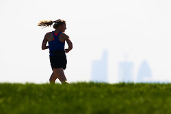A runner works up a sweat at the summit of Parliament Hill in London February 10 2018.