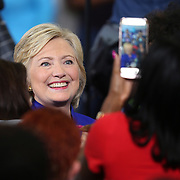 Democratic presidential candidate Hillary Clinton meets with attendees after a campaign stop at the Frontline Outreach Center in Orlando, Fla., on Wednesday, Sept. 21, 2016. (Alex Menendez via AP)