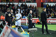 Wilfried Bony of Swansea city (10) the scorer of 2 goals is replaced late in the 2nd half but Swansea manager Garry Monk ® doesn't shake hands and appears to 'blank' him. Barclays Premier league match, Swansea city v Leicester city at the Liberty stadium in Swansea, South Wales on Saturday 25th October 2014<br /> pic by Andrew Orchard, Andrew Orchard sports photography.