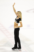 A Dallas Stars Ice Girl waves to the crowd during a timeout against the St. Louis Blues at the American Airlines Center in Dallas, Texas, on January 26, 2013.  (Stan Olszewski/The Dallas Morning News)