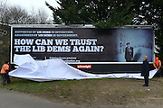 """© Licensed to London News Pictures. 25/02/2013. Eastleigh, UK. Brian Leggett, UK spokesperson for the International Consortium of British Pensioners  (ICBP) launches a billboard campaign in Eastleigh, Hampshire, today 25th February 2013. the """"How Can We Trust The Lib Dems Again"""" claims that pensioners who live abroad are unlikely to receive their full state pensions. Photo credit : Stephen Simpson/LNP"""