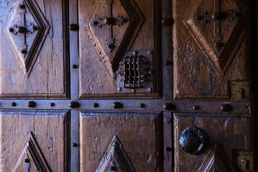 Detail of oak wooden door of Convent and church of San Esteban in Salamanca, Spain