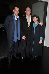 Left to right, SIMON DAVIS, REG GADNEY and FAYE MASCHLER at a private view of 'Engagement' an exhibition of new works by Jennifer Rubell held at the Stephen Friedman Gallery, 25-28 Old Burlington Street, London on 7th February 2011.