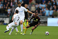 Raheem Sterling of Manchester city ® breaks away from Fernando Llorente of Swansea city © and Leon Britton of Swansea city.  Premier league match, Swansea city v Manchester city at the Liberty Stadium in Swansea, South Wales on Saturday 24th September 2016.<br /> pic by Andrew Orchard, Andrew Orchard sports photography.