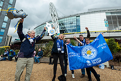 © Licensed to London News Pictures. 15/05/2021. LONDON, UK. Leicester City fans arrive outside Wembley Stadium ahead of the FA Cup Final between Chelsea and Leicester City.  21,000 fans will attend the match, the most for over a year due to the ongoing coronavirus pandemic and this match will be another data collection exercise for the UK government as it moves to relax lockdown restrictions for major live events.  Photo credit: Stephen Chung/LNP