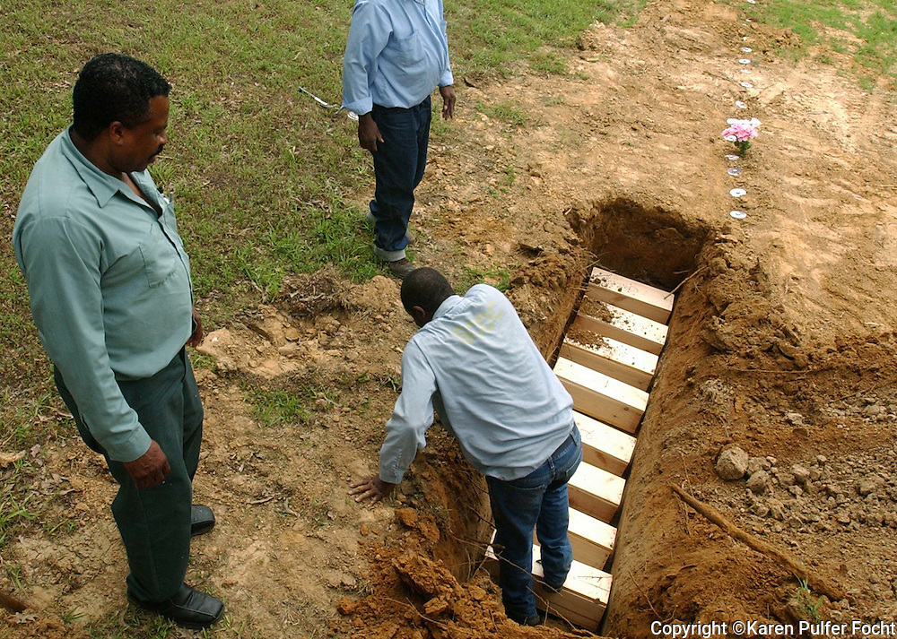 Inmates help Robert Savage bury babies in a trench in the counties public cemetery.  Memphis has the highest rate of infant mortality amoung the nation's 60 largest cities.