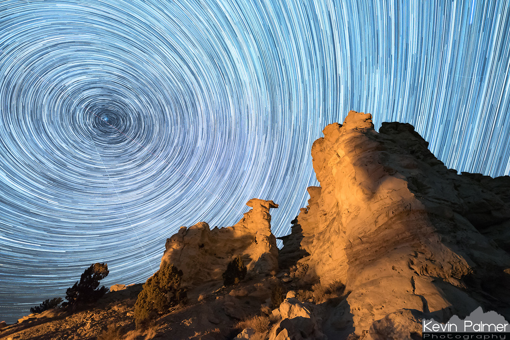While camping at Castle Gardens, I captured the stars for 2 hours to put together into this startrail image. A campfire cast a warm glow on the bluffs and hoodoos above.