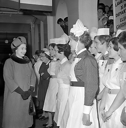 File photo dated 28/02/68 Queen Elizabeth II talking with NHS nursing staff during a visit to St. Thomas' Hospital, London. During her visit with the Duke of Edinburgh she opened the newly established Dimbleby Research Laboratory and unveiled a commemorative plaque. The NHS will celebrate its 70th anniversary on Thursday 5th July 2018.