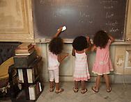 CUBA: Havana. children's fashion for little girls. In a   old decaying house. . in Havana vedado area     / Cuba. La Havane.  mode enfantine pour petite filles. dans une  vielle maison bourgeoise et baroque delabree La Havane Vedado,     ,
