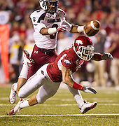 Nov 5, 2011; Fayetteville, AR, USA;  Arkansas Razorback cornerback Isaac Madison (6)  attempts to make a catch intended for South Carolina Gamecock wide receiver Shamier Jeffery (8) during the second half of a game at Donald W. Reynolds Stadium.  Mandatory Credit: Beth Hall-US PRESSWIRE