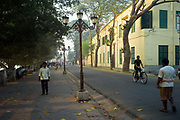 Pedestrians and cyclists on the Strand, the main French style avenue on the banks of the Hooghley River, Chandannagar, India