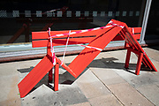 Colourful benches on the South Bank are taped off to prevent people sitting down and so to preserve social distancing as lockdown continues and people observe the stay at home message in the capital on 11th May 2020 in London, England, United Kingdom. Coronavirus or Covid-19 is a new respiratory illness that has not previously been seen in humans. While much or Europe has been placed into lockdown, the UK government has now announced a slight relaxation of the stringent rules as part of their long term strategy, and in particular social distancing.