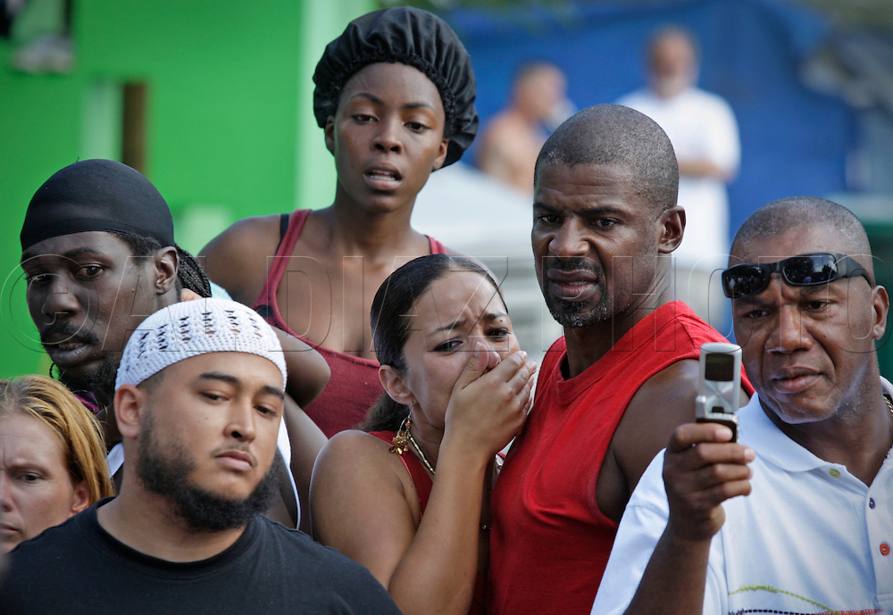 """Nadia Asencio and Paul Morrow, at center, reacts to watching the fighting on September 18, 2010. Dhafir Harris, """"Dada 5000"""", puts on backyard fights at his mother house, which go viral on youtube and have been the subject of documentaries. Sometimes the men fight until they are unconscious. There' s no gloves and occasionally, there's a cage. The community has taken to the events, because they are able to set up businesses selling food and washing cars."""