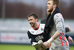 Falkirk's Mark Millar with Queen of the South's keeper Zander Clark at the end.<br /> Falkirk 1 v 0 Queen of the South, Scottish Championship game today at the Falkirk Stadium.<br /> © Michael Schofield.