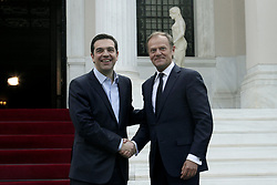 April 5, 2017 - Athens, Greece - Greek PM Alexis Tsipras (L) welcomes the President of the European Council Donald Tusk, at Maximos mansion, in Athens, on April 5, 2017  (Credit Image: © Panayotis Tzamaros/NurPhoto via ZUMA Press)
