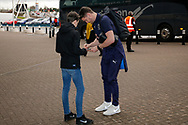 Wimbledon goalkeeper Joe McDonnell (24) signs an autograph on arriving during the EFL Sky Bet League 1 match between Coventry City and AFC Wimbledon at the Ricoh Arena, Coventry, England on 12 January 2019.