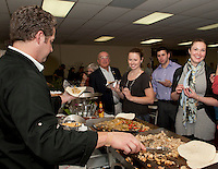 Sarah Beth Huot (far right) orders a chicken fahita with all the fixin's from Jim Contigiani during the 22nd annual Altrusa of Laconia's Taste of the Lakes Region Sunday afternoon at the Conference Center at Opechee Inn and Spa.   (Karen Bobotas/for the Laconia Daily Sun)