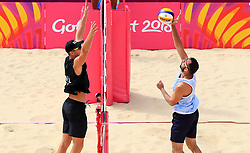 New Zealand's Sam O'Dea (left) and Cyprus' Dimitris Apostolou in action during the Men Preliminary - Pool Beach Volleyball match at Coolangatta Beachfront during day two of the 2018 Commonwealth Games in the Gold Coast, Australia.