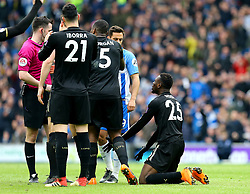 """Leicester City's Wilfred Ndidi (right) is sent-off by match referee Chris Kavanagh (left) during the Premier League match at the AMEX Stadium, Brighton. PRESS ASSOCIATION Photo. Picture date: Saturday March 31, 2018. See PA story SOCCER Brighton. Photo credit should read: Gareth Fuller/PA Wire. RESTRICTIONS: EDITORIAL USE ONLY No use with unauthorised audio, video, data, fixture lists, club/league logos or """"live"""" services. Online in-match use limited to 75 images, no video emulation. No use in betting, games or single club/league/player publications."""