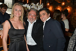 Left to right, MARIA PAGOLSKAYA, ROBERT TCHENGUIZ and KIA JOORABCHIAN at the launch of Korean restaurant Jinjuu with chef Judy Joo at 15 Kingley Street, London on 22nd January 2015.
