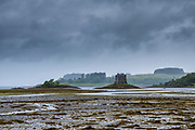 15th Century Stalker Castle tower house and the mudflats of Loch Laich at Appin, Argyll, Scotland. Beyond is Loch Linnhe,