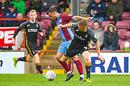 Eoin Doyle of Bradford City (9) and Clayton Lewis of Scunthorpe United (15) during the EFL Sky Bet League 1 match between Scunthorpe United and Bradford City at Glanford Park, Scunthorpe, England on 27 April 2019.