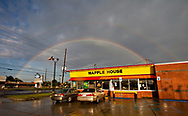 A double rainbow near a Waffle House in St. Bernard Parish on St. Claude Avenue, an area that was badly impacted by Hurricane Katrina. Five years after Hurricane Katrina, St. Bernard Parish is still recovering from the damage created by hurricane and the subsequent flooding when the levees broke. <br /> Commercial establishments such as the fast food chain,  Waffle House are indicators of the recovery that is still far from complete.