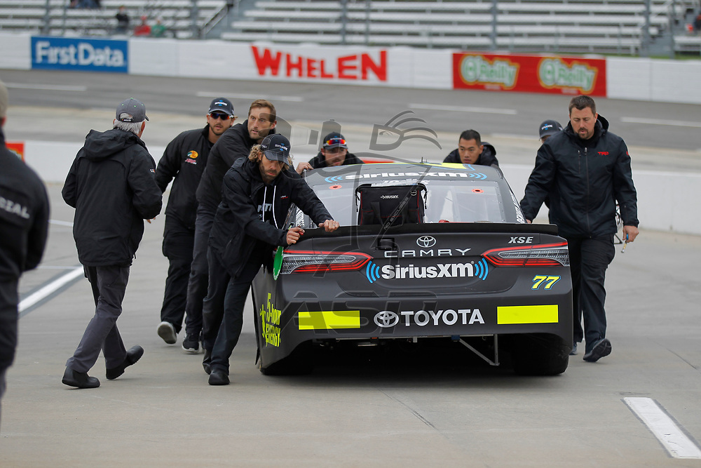 October 29, 2017 - Martinsville, Virginia, USA: Erik Jones (77) crew members push his car down pit road before qualifying for the First Data 500 at Martinsville Speedway in Martinsville, Virginia.