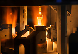 A robotic machine injects lamps with high pressure gas and seals them during the ceramic metal halide lamp manufacturing process, at the Philips Lighting factory, in Turnhout, Belgium, on Friday, Oct. 15, 2010. (Photo © Jock Fistick)