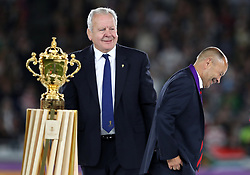England head coach Eddie Jones (right) walks past the Webb Ellis Cup and chairman of World Rugby Bill Beaumont during the 2019 Rugby World Cup final match at Yokohama Stadium.