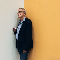 Jean-Paul Demoule, prehistorian & archeologist, posing in a corridor at the Institut National d'Histoire de l'Art. Paris, France. September 23, 2020. <br /> Jean-Paul Demoule, prehistorien & archeologiste, prenant la pose dans un couloir de l'Institut National d'Histoire de l'Art. Paris, France. 23 septembre 2020.