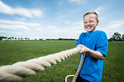 Young strong boy holding rope Tug-of-war strength
