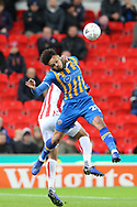 20 Aaron Holloway for Shrewsbury Town beats Stoke City's Ashley Williams to the ball during the The FA Cup 3rd round replay match between Stoke City and Shrewsbury Town at the Bet365 Stadium, Stoke-on-Trent, England on 15 January 2019.