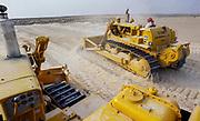Oil industry in Ras Tanura area, Saudi Arabia,  D6H caterpillar bulldozer  desert construction 1979