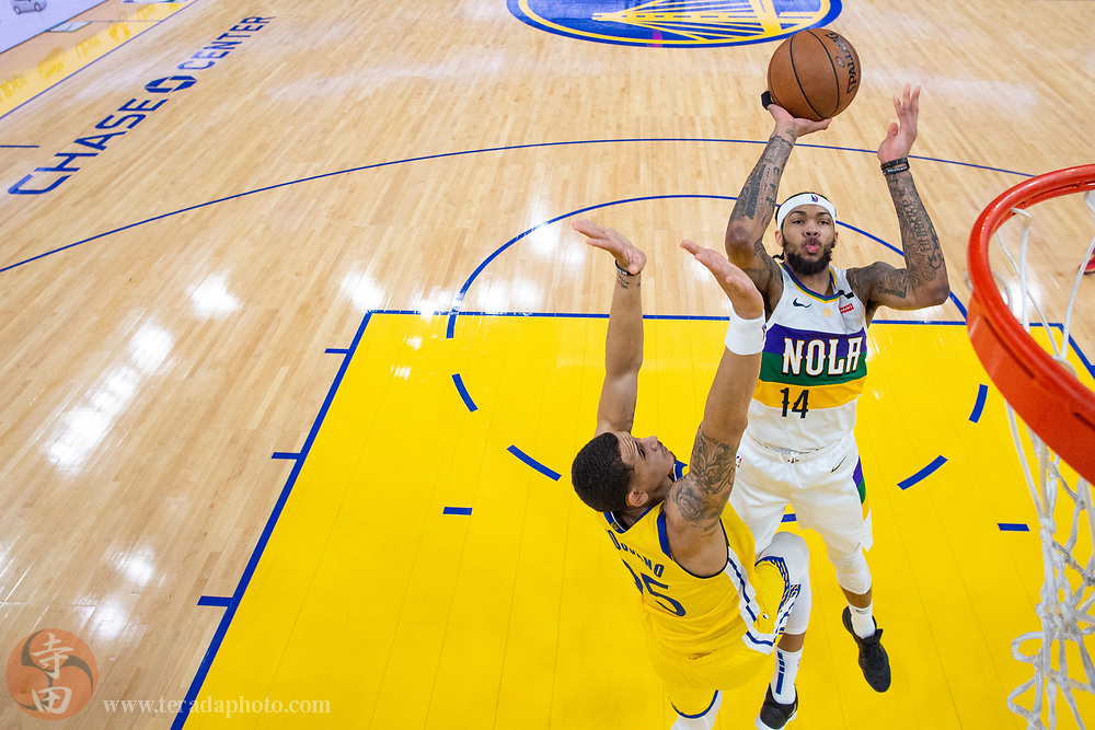 February 23, 2020; San Francisco, California, USA; New Orleans Pelicans forward Brandon Ingram (14) shoots the basketball against Golden State Warriors forward Juan Toscano-Anderson (95) during the second half at Chase Center.