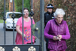 © Licensed to London News Pictures . 01/05/2013 . Wilmslow , Cheshire , UK . Two women leave The White House , home to actor Bill Roache MBE , this evening (1st May 2013) . Coronation Street actor , Bill Roache MBE has been arrested on charges of an historic rape against a 15 year old girl . Photo credit : Joel Goodman/LNP