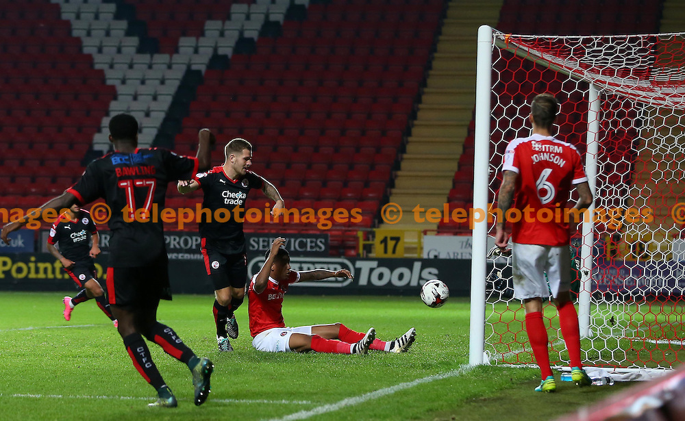 Crawley's James Collins scores during the Checkatrade Trophy match between Charlton Athletic and Crawley Town at The Valley in London. October 4, 2016.<br /> James Boardman / Telephoto Images<br /> +44 7967 642437