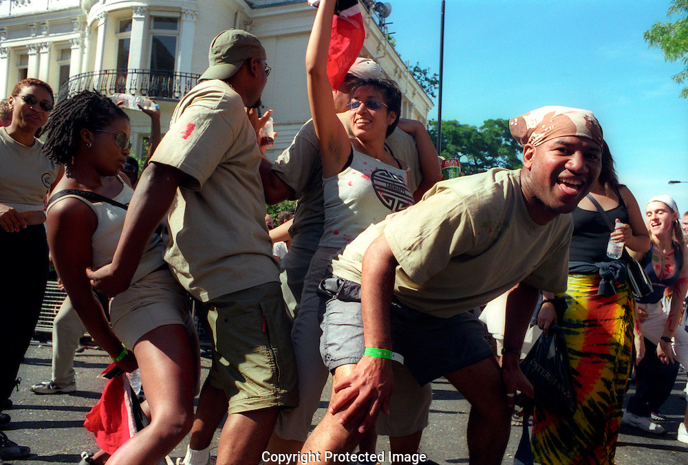 Dancing in the streets of Nottinghill Gate London at carnival time.