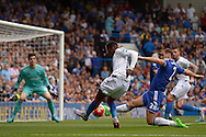 Wilfried Zaha of Crystal Palace has a shot blocked by Branislav Ivanovic, the Chelsea standing captain. Barclays Premier League, Chelsea v Crystal Palace at Stamford Bridge in London on Saturday 29th August 2015.<br /> pic by John Patrick Fletcher, Andrew Orchard sports photography.